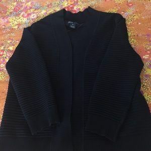Jacket like. No buttons